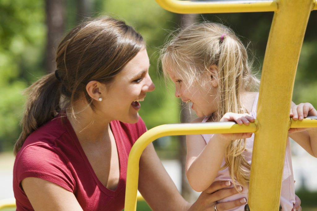 Mother and daughter smiling together at Longwood Park Playground